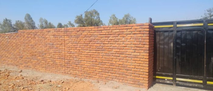 Wall repair at new gate